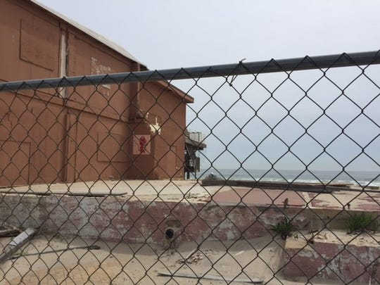 A fence guards the property where Joey Harrison's Surf