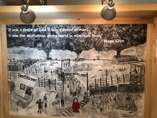A mural panel is seen from the Holocaust exhibit that will be shown in Henderson Friday and Sunday.