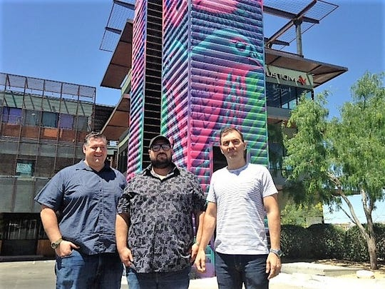 Rudy Valdes, left, Nick Salgado and Octavio Gomez stand outside the three-story office building that they developed in the Montecillo Smart Growth Community in West El Paso.