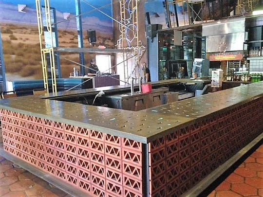 The Electric Cactus bar, still under construction, features a huge bar counter and a large outdoor patio.