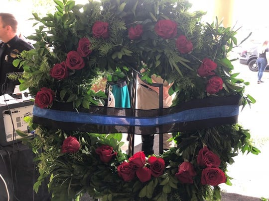 A wreath at the Lee County Fallen Officer Memorial Ceremony held Wednesday morning at Centennial Park
