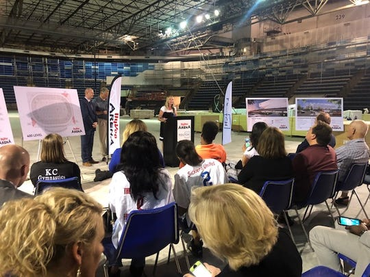 Julie Rischer, manager of Hy-Vee Arena, speaks at a