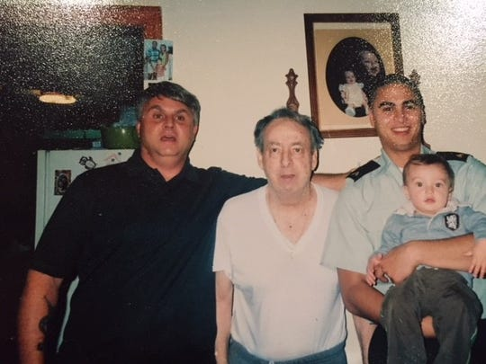 Louis Bazar Jr., left, poses for a photo with his father, Louis Bazar Sr., second from left, Bazar Jr.'s youngest son, right, and Bazar Jr's grandson.