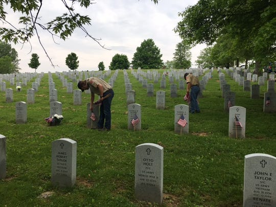 Volunteers placed flags on the graves of military veterans in preparation for a previous Memorial Day.
