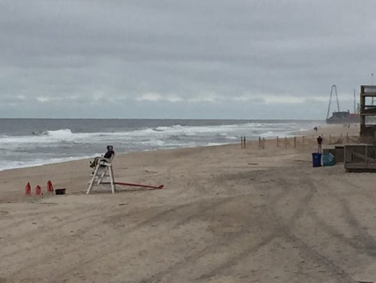Two lifeguards sit on an empty beach in Ortley Beach