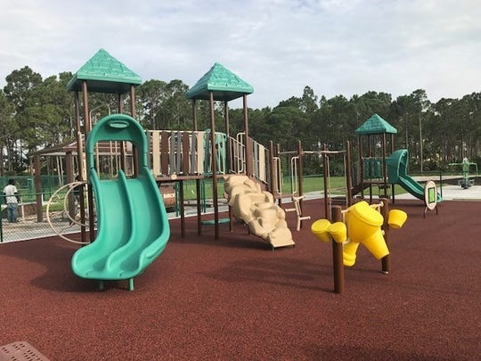 The new park includes a playground, along with a dog