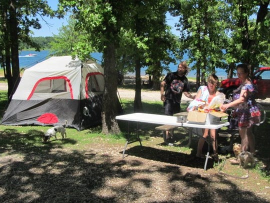 Setting up camp by the lake are Melissa McGirt, Darren