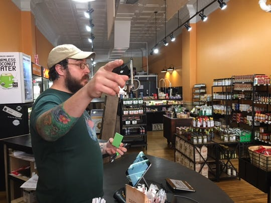 Tom Hirst, an employee at The 'Field Market downtown on North Main Street, Thursday described the deer incident to customers.