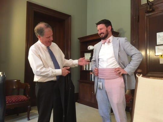 Sen. Doug Jones, D-Ala., showed off staffer Darrin Kinnaird who sported a colorful seersucker suit.