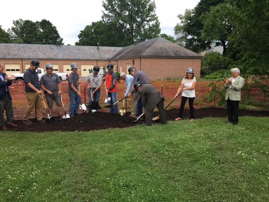 A dozen people put their shovels in the ground Monday