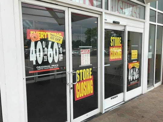 Store closing signs advertise deep discounts at Carson's.