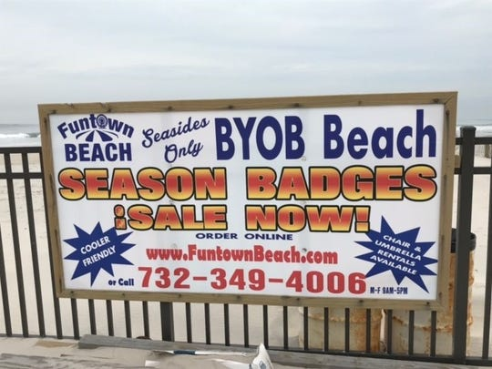 A sign advertises Funtown beach, where a party on June 16 attracted hundreds of revelers.