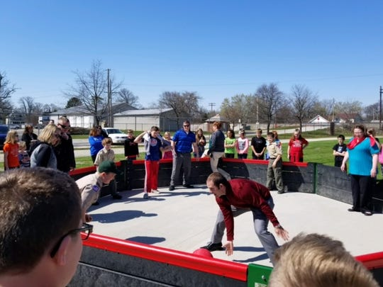 Oak Harbor Middle School Principal Laramie Spurlock plays gaga ball with students in the new gaga ball pit.