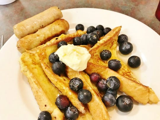Grandpa's Diner's French toast with blueberries and  two large sausage links. French Toast and Pancakes are offered in twos, threes or fives.