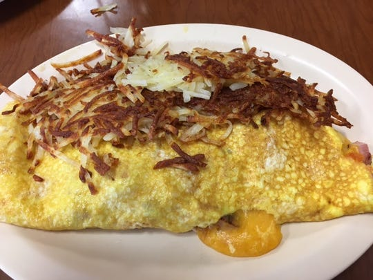 Loaded with extra cheese and extra meat, the Meat & Cheese Omelet is a breakfast staple at the Lil' Chef Cafe.