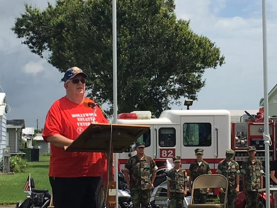 Navy veteran Austin Duggan speaks to a crowd of about 150 at a flag-raising ceremony at Hollywood Estates in West Melbourne.