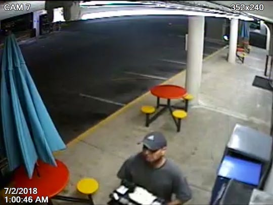 Security camera footage shows a man police say robbed