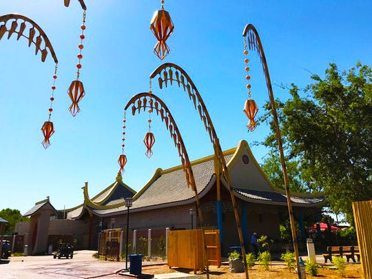 Asia Gateway hanging metal baskets at the El Paso Zoo.