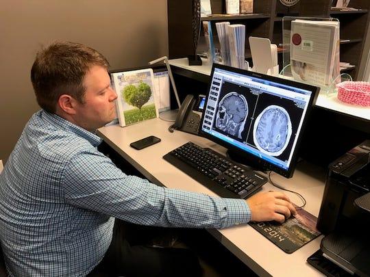Dr. Stephen Dyar looks at Shane Gentry's latest MRI,