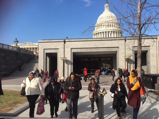 Women attending the Black Women's Roundtable in March head to Senate offices to discuss issues impacting communities of color.