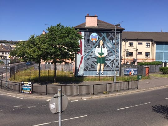 A peace mural commemorating a 14-year-old child victim
