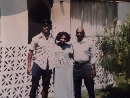 Herm Edwards with his sister, Irvina, and father, Herman Sr., at their home in Seaside, Calif.