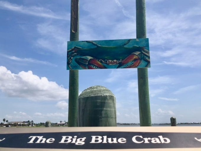 A painting of a blue crab is up in the spot of the