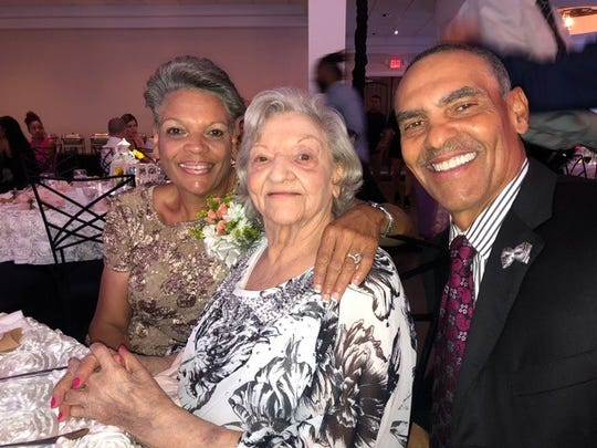 ASU football coach Herm Edwards with his mother Martha, center, and sister Irvina Perez at a family wedding on June 30, 2018.