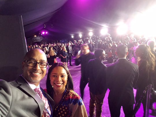 "Comic book artist and book author Shawn Martinbrough takes a selfie with his wife, Ayanna Ross-Martinbrough, while attending the world premiere of Marvel's ""Black Panther"" movie in Los Angeles in late January 2018."