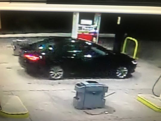 Surveillance footage of the vehicle driven by an armed