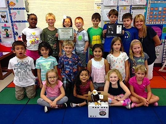 "Traci Bratcher and her class of first-graders in the fall of 2015 pose with their stuffed animal eagle. The class ""adopted"" an eagle from CROW, The Clinic for the Rehabilitation of Wildlife in Sanibel."