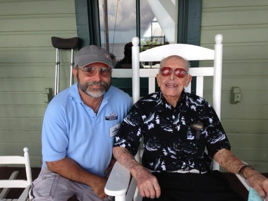 Historian and writer Patrick Mesmer (left) enjoyed swapping tales of early Martin County with Curt Whiticar on the front porch of the House of Refuge Museum, August 2016.