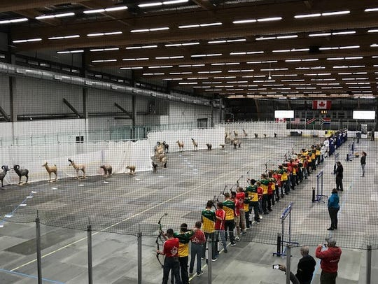 Archers compete in a hockey rink in Canada in July