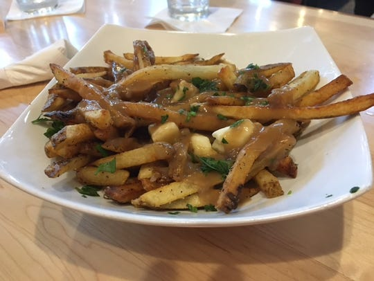 Perfect for sharing, Albion Malleable offers Poutine.