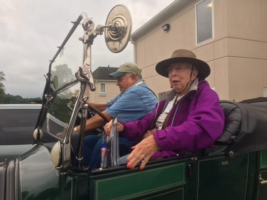 George and Nancy Haley of Clifton, Illinois, are dressed for the weather Wednesday as they ride in their 1913 Peerless to numerous tourist attractions throughout Richland County.