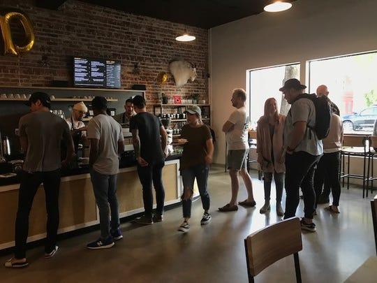 Customers stand in line Wednesday, Oct. 3, 2018, inside