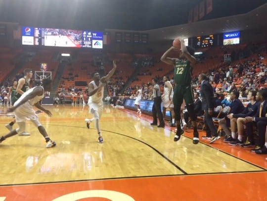 Charlotte's Malik Martin launches a 3-pointer as Ountae