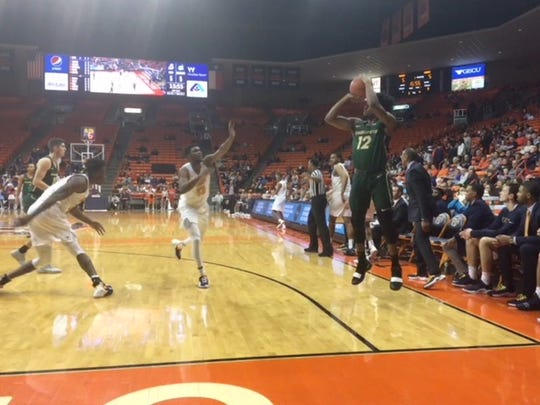 Charlotte's Malik Martin launches a 3-pointer as Ountae Campbell runs over to defend Saturday at the Don Haskins Center
