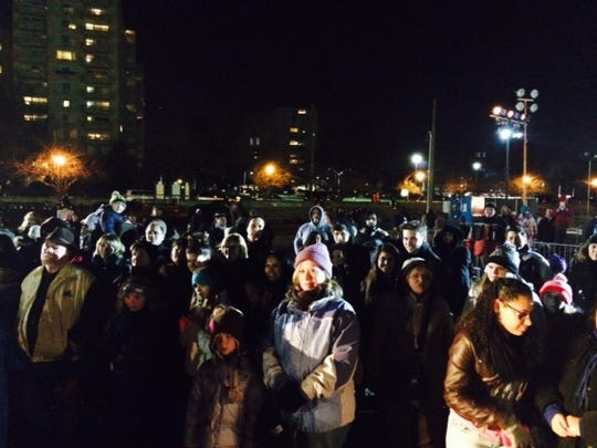 Bundled visitors watch opening ceremonies at last year's WinterFest in Pennsauken. The event includes food, music, vendors, horse-and-carriage rides and of course, skating.