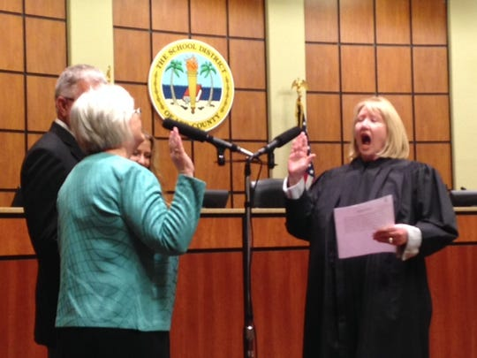Pam LaRiviere being sworn in to th Lee County School Board on Tuesday.