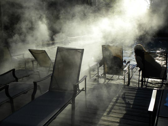 Steam rises from the pool that is fed by Belknap hot