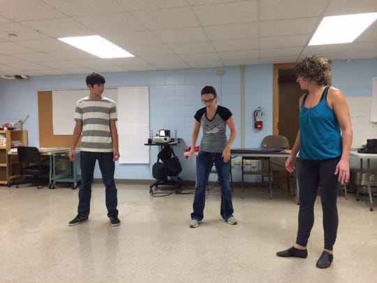 Victor Hofmeister and Jessica Boivin practice their jazz number with choreographer Bridget Hofmeister (center).