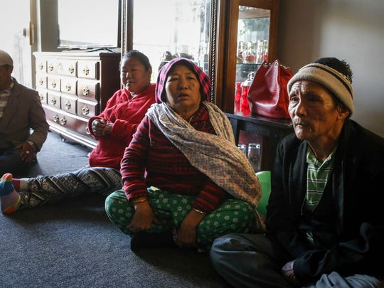 Refugees from Bhutan visit on Saturday, Dec. 2, 2017, at the Deer Ridge apartment complex in Des Moines. The apartments are not on any public transportation routes, and with limited means of mobility, many refugees in the complex walk miles to fetch groceries. The walk includes a stretch along SW 63rd Street.