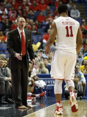 Illinois State head coach Dan Muller, left, looks at MiKyle McIntosh after Mcintosh fouled out during the second half of an NCAA college basketball game against Wichita State in the championship of the Missouri Valley Conference tournament.