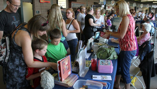 Reading fans line the promenade of TD Bank Ballpark in Bridgewater to meet 10 New Jersey authors during the Super Summer Reader Club celebration at Tuesday night's Somerset Patriots game.