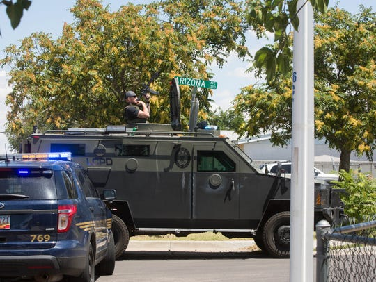 Las Cruces Police Department's SWAT team move into