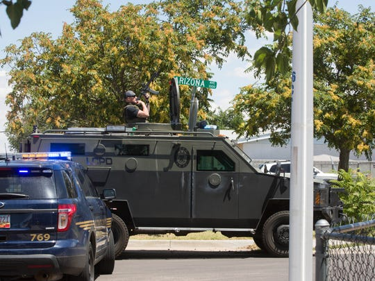 Las Cruces Police Department's SWAT team move into a location where around 11:30 Las Cruces Police Department recieved a call about an armed  person and suspisious activity, when LCPD arrived on the scene the person was barricaded in a vehical. Monday July 17, 2017.