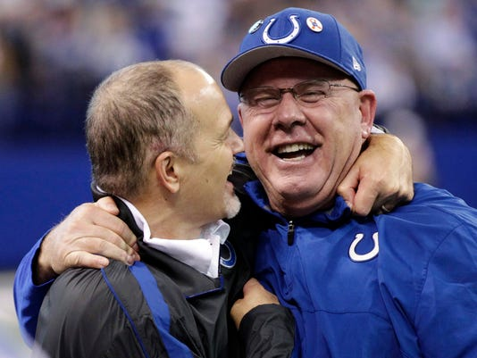 Indianapolis Colts head coach Chuck Pagano, left, celebrates with offensive coordinator Bruce Arians after a win in December. Arians took over as head coach when Pagano was under treatment for leukemia, leading the Colts to a 9-3 record.