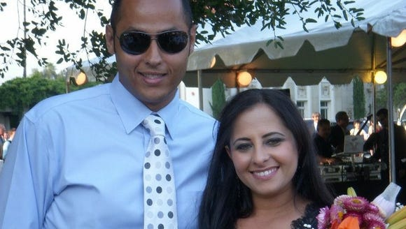 Dr. Hala Sabry-Elnaggar poses with her husband Mohamed