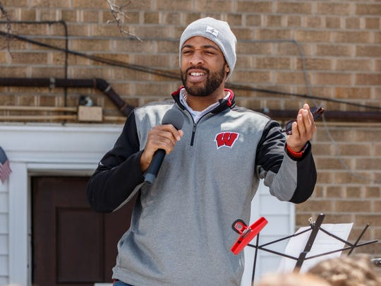Mandela Barnes, a former state representative from Milwaukee and candidate for lieutenant governor, speaks to students from Oconomowoc High School during a student walkout/rally to raise awareness about gun violence and school safety in downtown Oconomowoc on Friday, April 20, 2018.